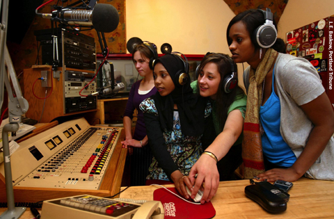 Youth learning radio skills in KBOO's Production 1 Studio.