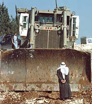 Palestinian man standing in front of Bethlehem bulldozer