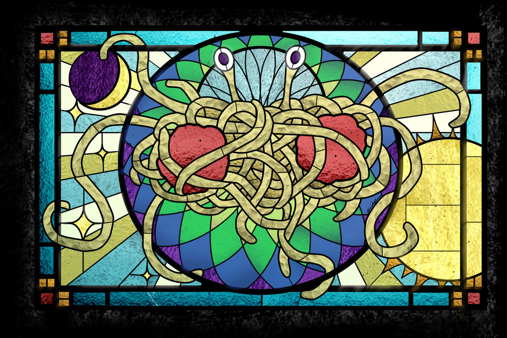 stained glass image of the flying spagetti monster