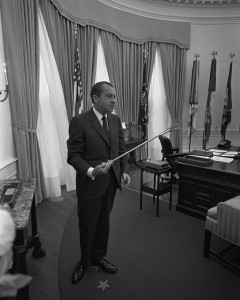 Richard Nixon with lunar tongs. Photo courtesy of the White House / National Archives.