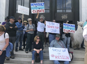 Climate activists protest OR republican legislators fleeing the state