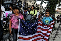 RadioActivist - kids hold the US flag in a parade